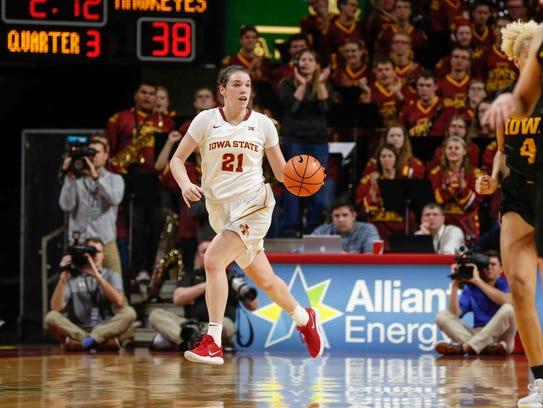 Iowa State junior Bridget Carleton moves the ball up