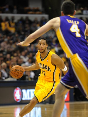 Indiana's Evan Turner drives up the court towards Los Angeles' Ryan Kelly in the second quarter  as the Indiana Pacers hosted the Los Angeles Lakers at Bankers Life Fieldhouse Tuesday February 25, 2014.
