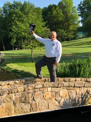 Retiring golf coach Rich Attonito mirrors Arnold Palmer's farewell wave at Mendham's final home match.