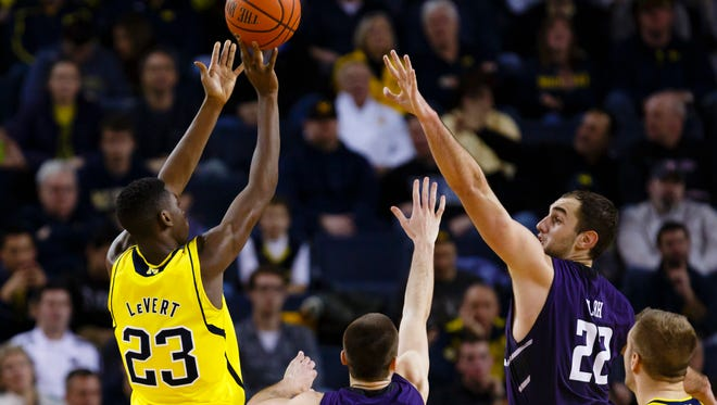 Michigan Wolverines guard Caris LeVert (23) shoots over Northwestern Wildcats center Alex Olah (22) in the second half at Crisler Center. Michigan won 56-54.
