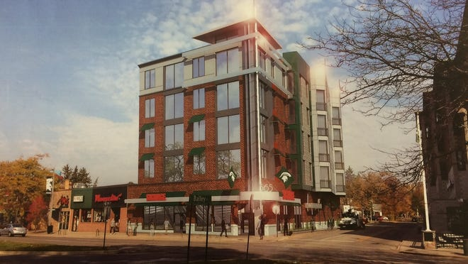 An artist's rendering of a proposed five-story building at the corner of Grand River Avenue and Bailey Street in downtown East Lansing. Developers want to replace the former Taco Bell restaurant building with new ground-floor retail and apartments.