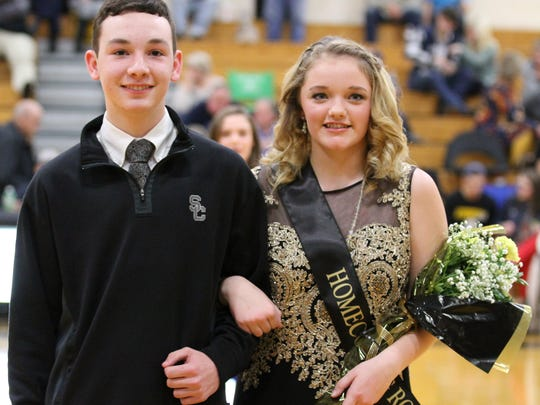 Sophomore Attendant Harley Mathis and her escort William