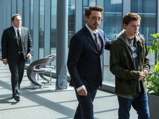 Jon Favreau (from left), Robert Downey Jr. and Tom