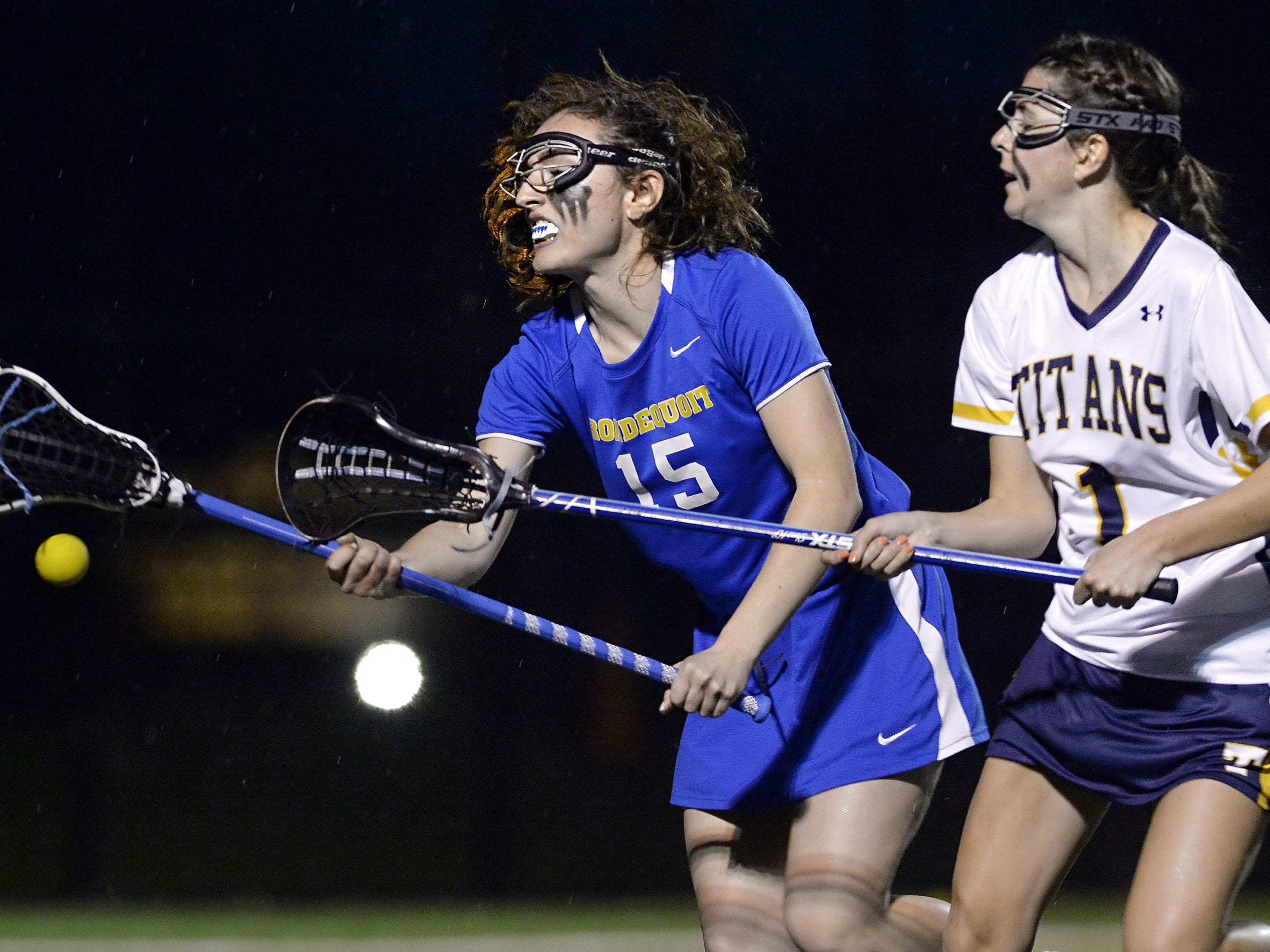 Webster Thomas' Mackenzie Travis, right, and Irondequoit's Miranda Clark chase a loose ball.