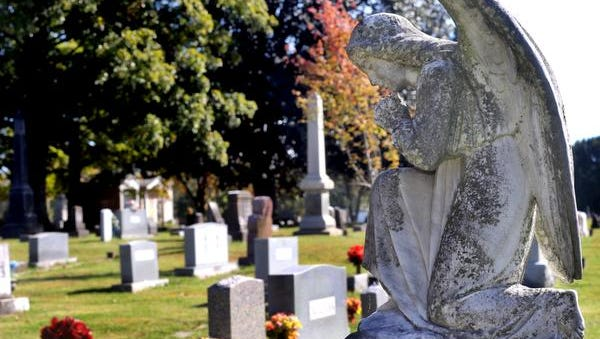 A praying angel at Evergreen Cemetery on Tuesday, Oct. 20, 2015. The monument is over Sarah Beth Gardner Campbell's grave that died in 1996 at the age of 49.