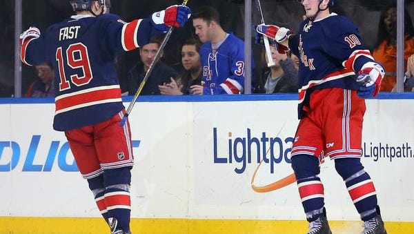 J.T. Miller, right,  is congratulated by Jesper Fast after scoring a goal against the Philadelphia Flyers during the third period Saturday at Madison Square Garden. Fast also scored as the Rangers won, 5-2.