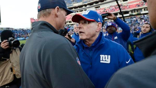 Giants coach Tom Coughlin, right, greets Tennessee Titans coach Ken Whisenhunt after Sunday's game in Nashville. The Giants won 36-7.