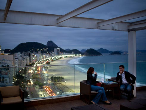 Tourists look over Copacabana Beach in Rio de Janeiro, the host city for this year's World Cup -- a definite draw for thousands of soccer fans.