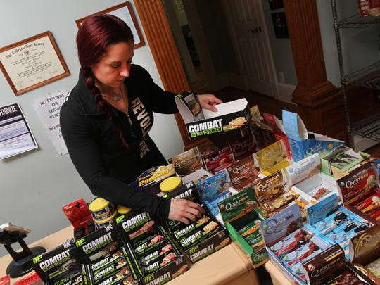 Michele Zandman-Frankel restocks some of the items sold by Revolutionize, a nutritional counseling business based in Freehold.