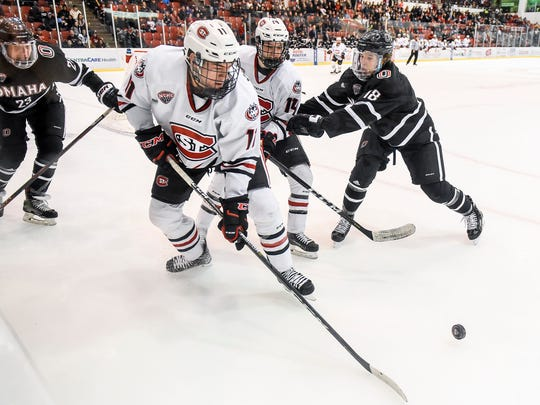 St. Cloud State's Ryan Poehling gets the puck out from