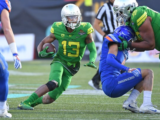 Dec 16, 2017; Las Vegas, NV, USA; Oregon Ducks wide receiver Dillon Mitchell (13) runs up field during the second half of play against the Boise Broncos in the 2017 Las Vegas Bowl at Sam Boyd Stadium. Mandatory Credit: Stephen R. Sylvanie-USA TODAY Sports