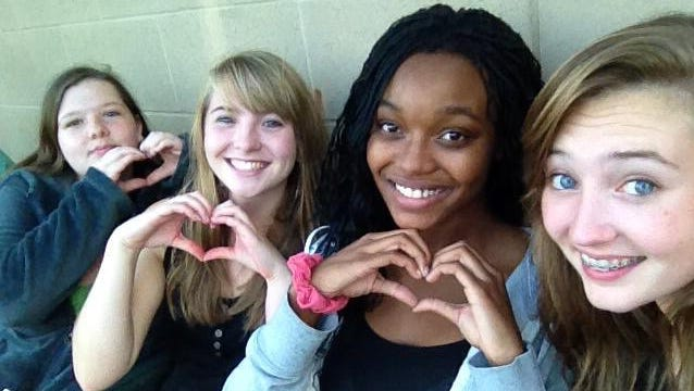 Sarah King, second from left, and Annie King, far right, enrolled this year as full-time students at Tech High School, where they found lots of love.