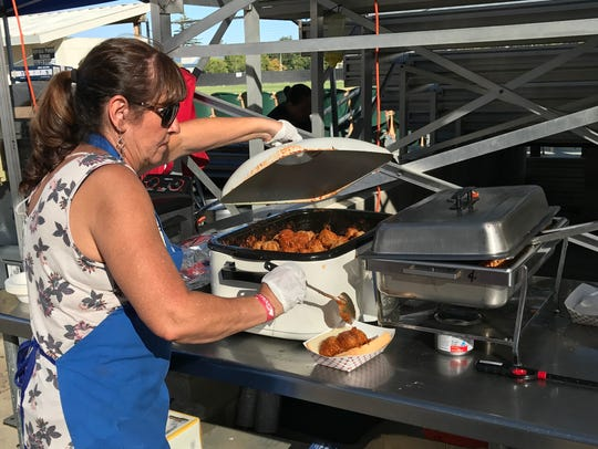 Sons of Italy member Mauna Stockton prepares a meatball