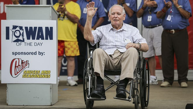 Former Gov. Bob Ray waves to an appreciative Iowa State Fair crowd on Friday, Aug. 8, after being named the Iowan of the Day. He was the first elected official to get the honor.