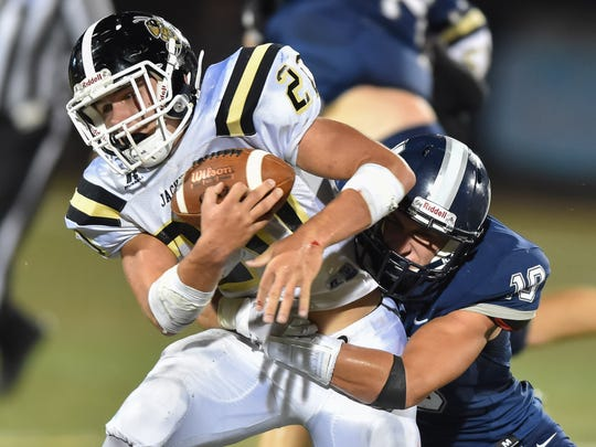 Oak Forest running back Thomas Lee (20) runs the ball against Jackson Academy during game action Friday in Jackson.