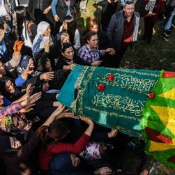 Women carry the coffin of one of the victims of the twin bombings in Ankara during her funeral on Oct. 12, 2015, in Istanbul.