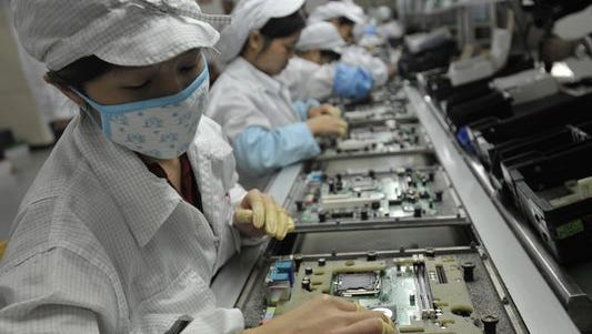 Workers at a Foxconn factory in Shenzen, China assemble electronic products in May 2010.