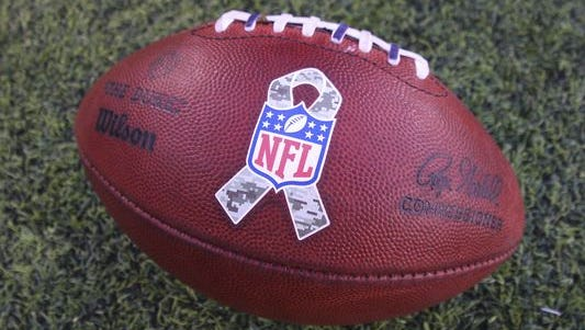 A NFL football with the Armed Services logo during the NFL game between the New York Jets and the Pittsburgh Steelers at MetLife Stadium.