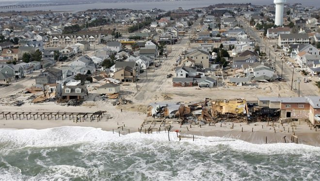 Superstorm Sandy damage in Ortley Beach, N.J., was viewed during a flight along the Jersey coastline on Nov. 18, 2012. Cassandra Vitale's Bucket Brigade helped residents in Ortley Beach clean up after Sandy. Vitale died Friday, July 31, 2015, at the age of 29.