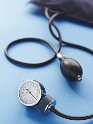 blood pressure cuff on blue background