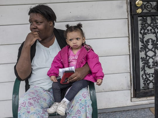 """""""I'm scared,"""" said Alethea Mitchell, as she sat on her porch Monday on Forrer Street with her 1-year-old niece, Kyla Hall, just a few blocks away from where 6-month-old Miracle Murray was killed in the 18000 block of Winthrop."""