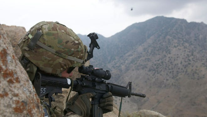 """A National Guard fighter from Oklahoma draws a bead on an enemy that is hard to see in the documentary """"Citizen Soldier."""""""