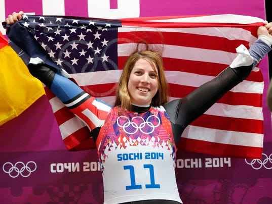 2014-2-12 erin hamlin and flag 1