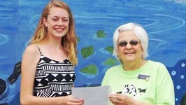 Lizzy St. Clair awarded the Friends of All Animals $1,000 scholarship from President Gloria Pushnik