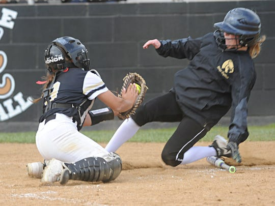 Abilene High catcher Hannah Lopez, left, returns this season. She's shown here making a tag to preserve a 1-0 lead against Keller Fossil Ridge in a 2018 game. AHS won 2-1 in eight innings.