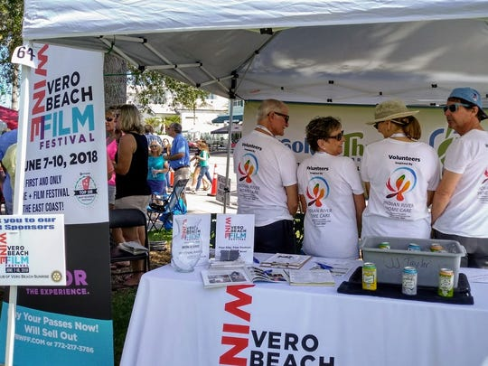 Vero Beach Wine + Film Festival volunteers show off