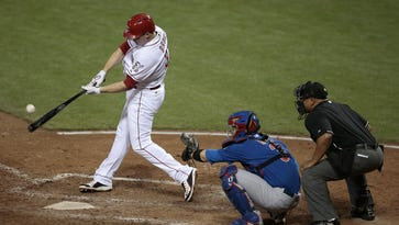 Cincinnati Reds right fielder Jay Bruce (32) flies out to right field in the bottom of the seventh inning of the MLB game between the Cincinnati Reds and the Chicago Cubs at Great American Ball Park in Cincinnati on Wednesday, Sept. 30, 2015.