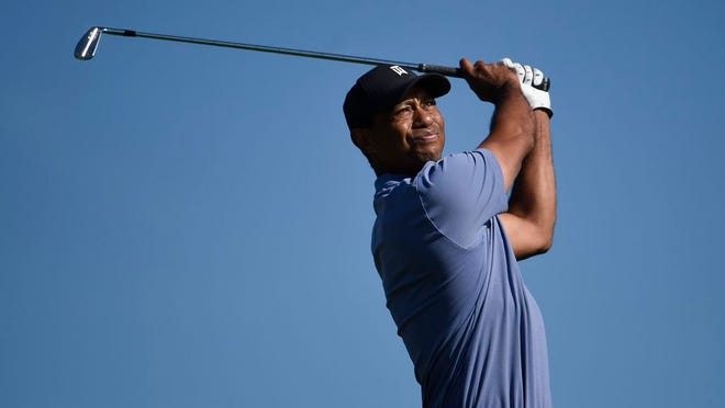 Tiger Woods hits hit tee shot on the 15th hole of the North Course at Torrey Pines Golf Course during the first round of the Farmers Insurance golf tournament Thursday Jan. 23, 2020, in San Diego.