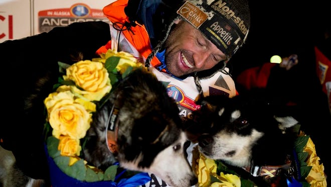 From March 18, 2020, Thomas Waerner, of Norway, celebrates in Nome, Alaska, his win in the Iditarod Trail Sled Dog Race. Waerner is still waiting to return to his home in Norway. Waerner and his 16 dogs have been stranded in Alaska by travel restrictions and flight cancellations caused by the coronavirus pandemic.