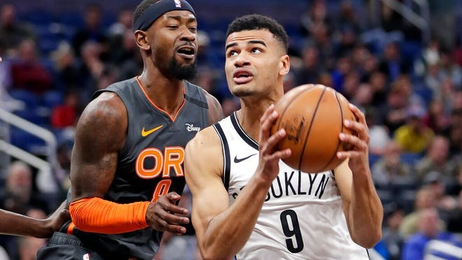 Brooklyn Nets guard Timothe Luwawu-Cabarrot (9) looks to shoot against Orlando Magic guard Terrence Ross, left, during the second half of an NBA basketball game, Monday, Jan. 6, 2020, in Orlando, Fla.