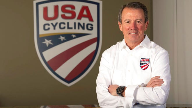 In this image provided by USA Cycling, Rob DeMartini, CEO of USA Cycling, poses at his offices in Colorado Springs, Colo. One year into his tenure at USA Cycling, Rob DeMartini is pushing the sport's governing body in a new direction. It will still support elite athletes, especially in the lead-up to the 2020 Summer Olympics in Tokyo. But it intends to take a bigger and more visible role in the growth of cycling at all levels.