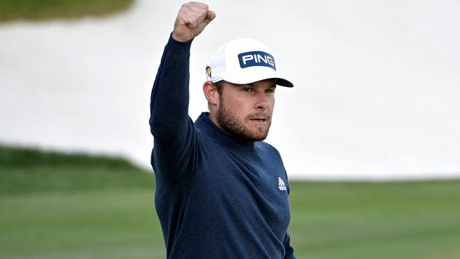 Tyrrell Hatton, of England, celebrates after sinking a putt for birdie on the 18th green to take the lead during the third round of the Arnold Palmer Invitational golf tournament, Saturday, March 7, 2020, in Orlando, Fla.
