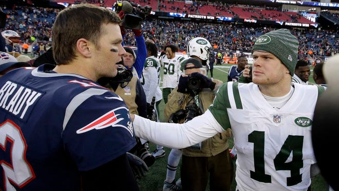 New England Patriots quarterback Tom Brady, left, and New York Jets quarterback Sam Darnold, right, speak at midfield after an NFL Football game, Sunday, Dec. 30, 2018, in Foxborough, Mass.