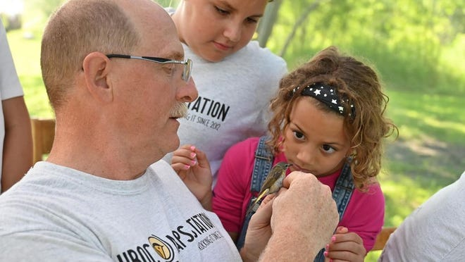 John Loegering demonstrates at a bird-banding event at the UMN Crookston Natural History Center. Photo by Terry Tollefson.