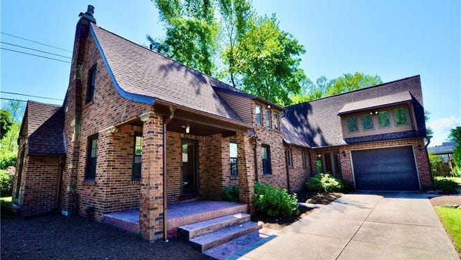 This attractive brick home at 2011 Lakeside Drive is listed for sale at $225,000.