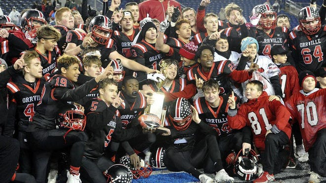 Orrville players celebrate in Tom Benson Hall of Fame Stadium after winning the 2018 OHSAA Division V state championship. Mike Schenk, The-Daily-Record.com