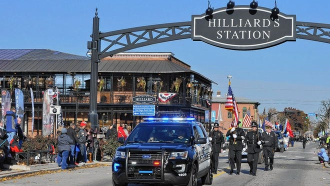 The Hilliard Division of Police honor guard leads Hilliard's Veterans Day parade Nov. 11, 2018, as it passes First Responders Park in Old Hilliard en route to the Veterans Memorial at Roger A. Reynolds Municipal Park. This year's parade has been canceled because of the COVID-19 coronavirus pandemic.