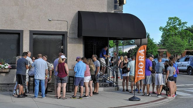 Patrons enjoy a Designated Outdoor Refreshment Area event, known as DORA, on June 14, 2018, outside Sports on Tap in Old Hilliard. Canal Winchester City Council is discussing the idea of creating a DORA, which is seen by many as an economic-development driver used to attract shoppers or diners.