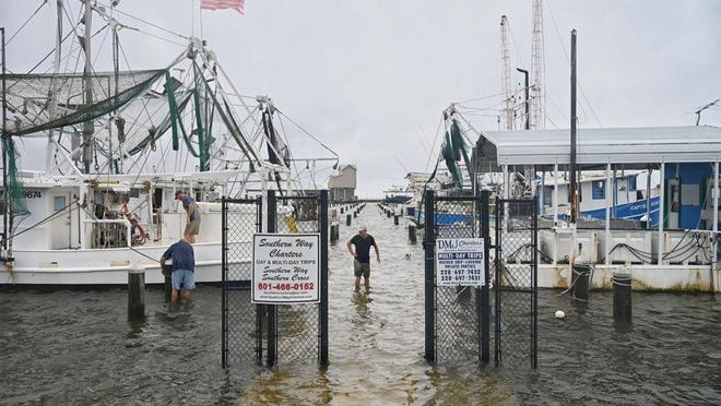 Owners tie down and secure their boats Sunday in the Pass Christian Harbor in Pass Christian, Miss., on the Mississippi Gulf Coast ahead of Tropical Storm Cristobal's landfall.