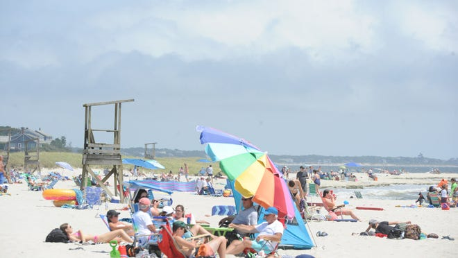 Beachgoers fill up the real estate at Red River Beach Wednesday afternoon.