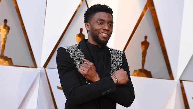 In this March 4, 2018 file photo, Chadwick Boseman arrives at the Oscars at the Dolby Theatre in Los Angeles. Actor Chadwick Boseman, who played Black icons Jackie Robinson and James Brown before finding fame as the regal Black Panther in the Marvel cinematic universe, has died of cancer. His representative says Boseman died Friday, Aug. 28, 2020 in Los Angeles after a four-year battle with colon cancer. He was 43.
