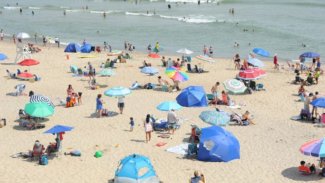 Beach umbrellas fill up Marconi Beach near noon Tuesday. The National Park Service celebrated its 104th birthday Tuesday and waived entrance fees to its parks including beach fees at the Cape Cod National Seashore.