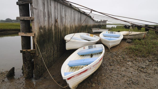 Boats gather on the bottom of Short Wharf Creek as the tide rolls out.