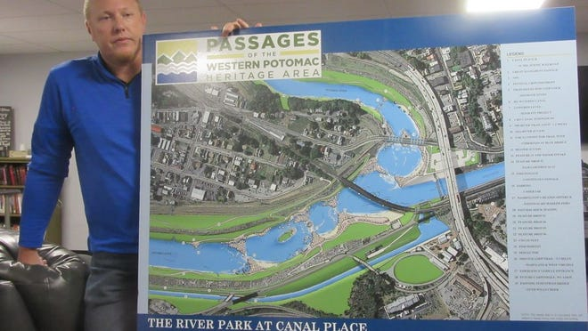 Jim Christie, senior project manager for Civil & Environmental Consultants Inc., recently shared the concept of River Park at Canal Place with the Ridgeley mayor and council.  Tribune photo by Ronda Wertman