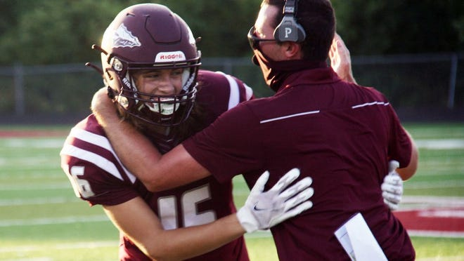 Osage sophomore receiver Hunter Graber (left) celebrates his touchdown reception with Head Coach Devin Johnson in the season opener against Fulton on Friday, August 28 in Osage Beach. Graber's touchdown catch from junior quarterback Brockton McLaughlin was Osage's first play of the 2020 season.