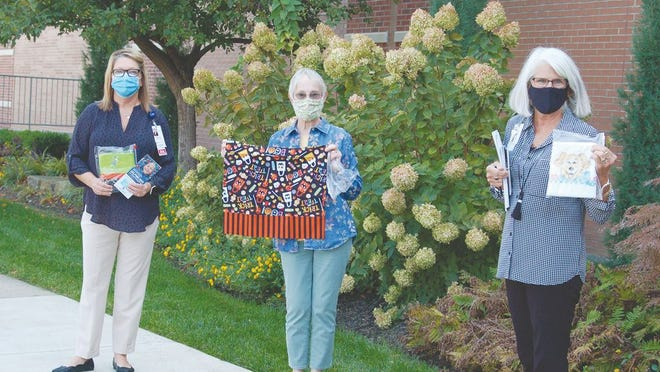 Volunteers from the Mid-Missouri chapter of Ryan's Case for Smiles donated hand-sewn pillowcases to hospitalized children at Lake Regional. Ginger Beasley, the Mid-Missouri coordinator, is pictured with Mary Lou Gamm, R.N, BSN, RCN-OB, Lake Regional Women and Children's Service Line director, and Terri Hall, CTFA, Lake Regional Fund Development director.